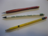 Examples of auto-advance pencils that are not provided with a push button mechanism. Top to bottom: a Paper Mate Advancer, a Fila Temagraph Automatic, and a M&G Comrade